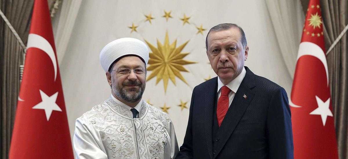 File: Turkey's President Recep Tayyip Erdogan, right, shakes hands with Ali Erbas, Chief of Religious Affairs, at his palace in Ankara, Turkey, Wednesday, Sept. 27, 2017. / AP