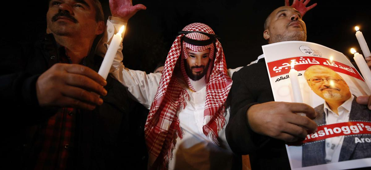 An activist, wearing a mask depicting Saudi Crown Prince Mohammed bin Salman, holds up his hands, painted with fake blood as he protests the killing of Saudi journalist Jamal Khashoggi, during a candlelight vigil outside Saudi Arabia's consulate in Istanbul, Thursday, Oct. 25, 2018. (AP)
