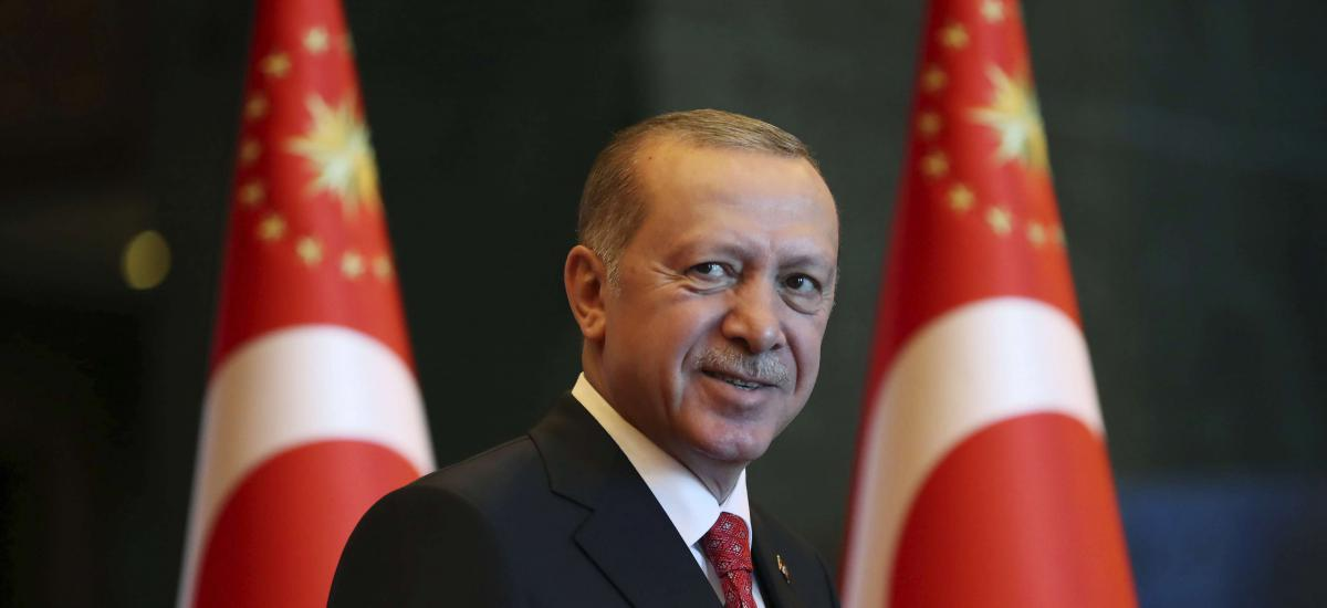 Turkey's President Recep Tayyip Erdogan smiles during a reception at his palace on the Republic Day, in Ankara, Turkey, Monday, Oct. 29, 2018. (Presidential Press Service via AP, Pool)