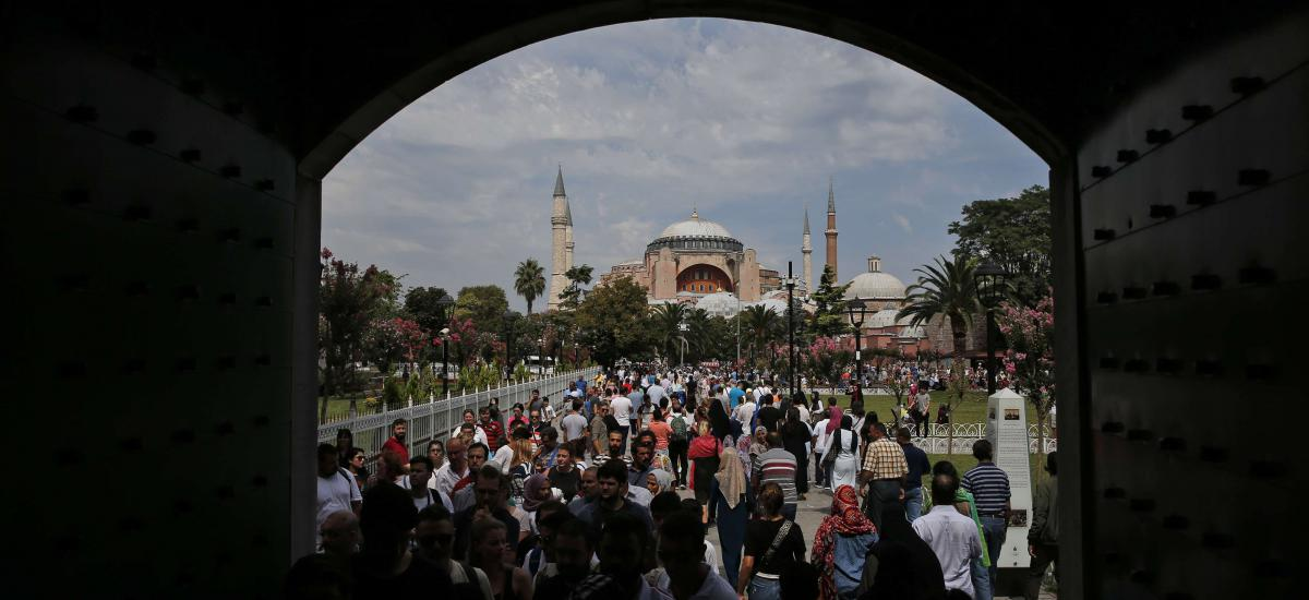In this Friday, Aug. 17, 2018 file photo, visitors walk towards the Byzantine-era Hagia Sophia, one of Istanbul's main tourist attractions, in the historic Sultanahmet district of Istanbul.