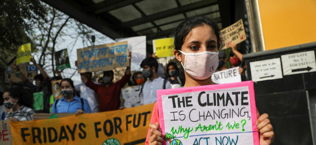 People take part in a 'Fridays for Future' march towards the Delhi Secretariat building, calling for urgent measures to combat climate change, in New Delhi, India, March 19, 2021. REUTERS/Anushree Fadnavis
