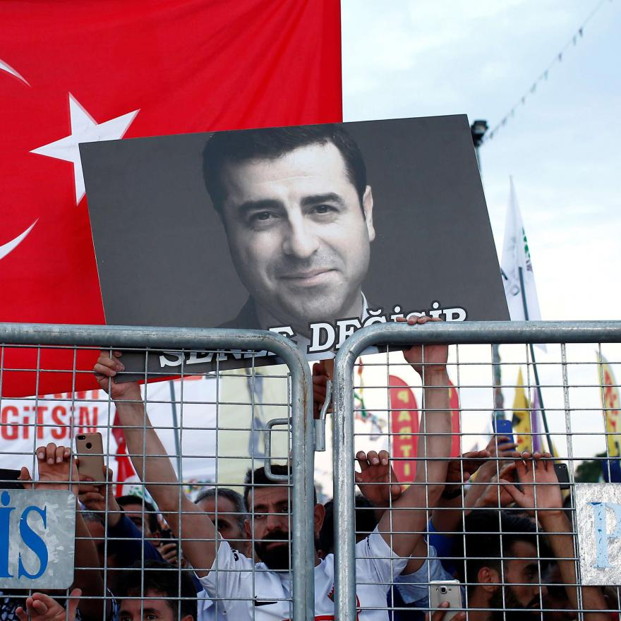 A supporter of Turkey's main pro-Kurdish Peoples' Democratic Party (HDP) holds a portrait of their jailed former leader and presidential candidate Selahattin Demirtas during a campaign event in Istanbul, Turkey, June 17, 2018. (Reuters)