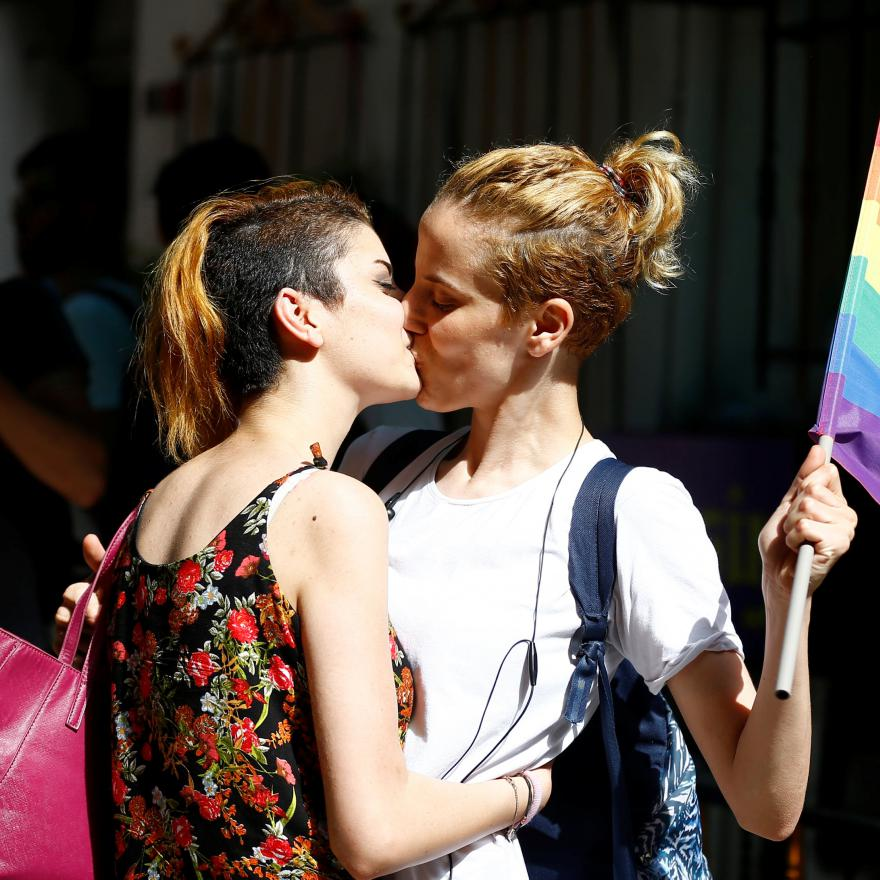 LGBT rights activists kiss during a transgender pride parade which was banned by the governorship, in central Istanbul, Turkey, June 19, 2016. (Reuters)