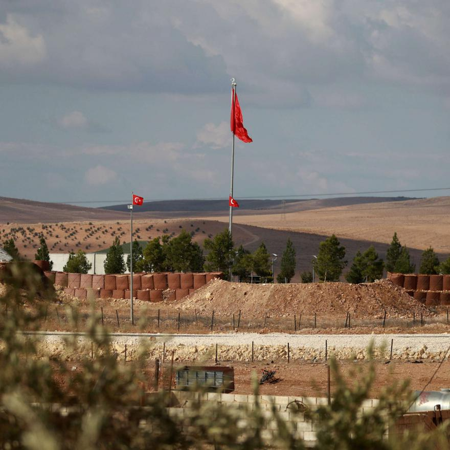 A general view shows Turkish flags are flying at a military post in the countryside village of Ashma in the Kurdish city of Kobane in northern Syria on November 8, 2018. (AFP)
