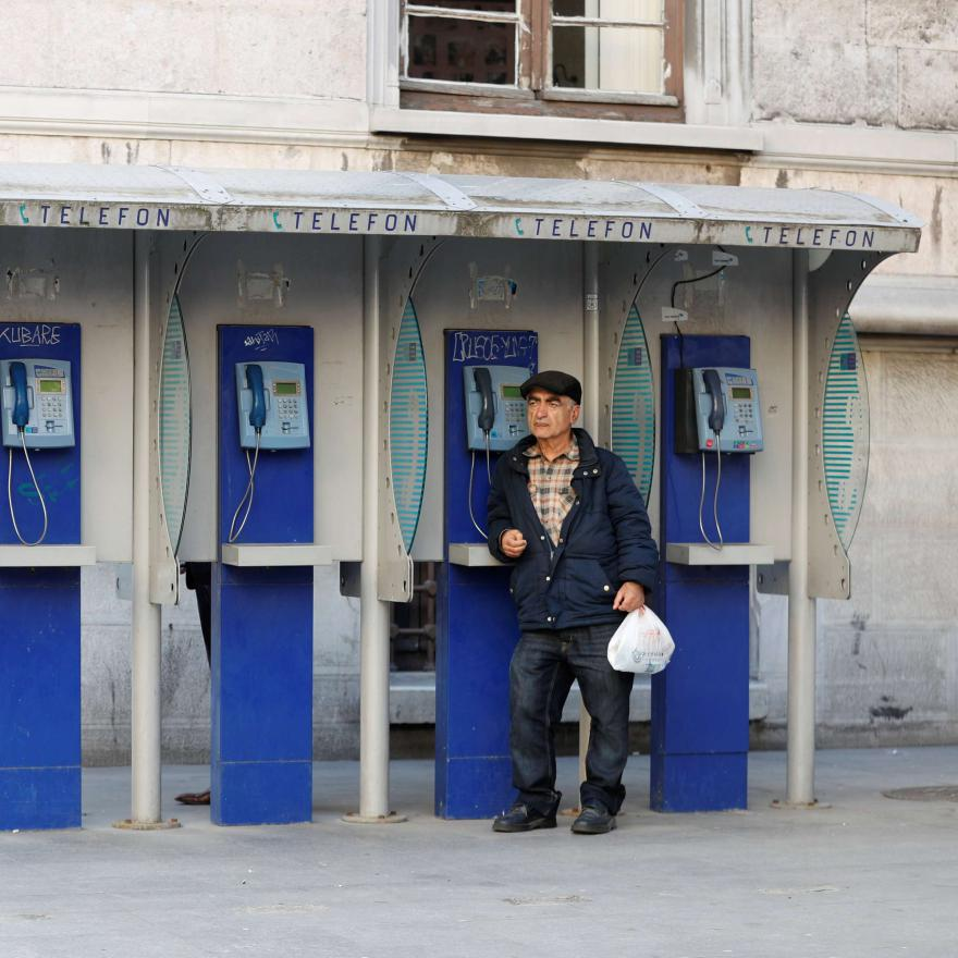 A man stands next to public phones in Istanbul, Turkey, November 8, 2017. REUTERS/Murad Sezer