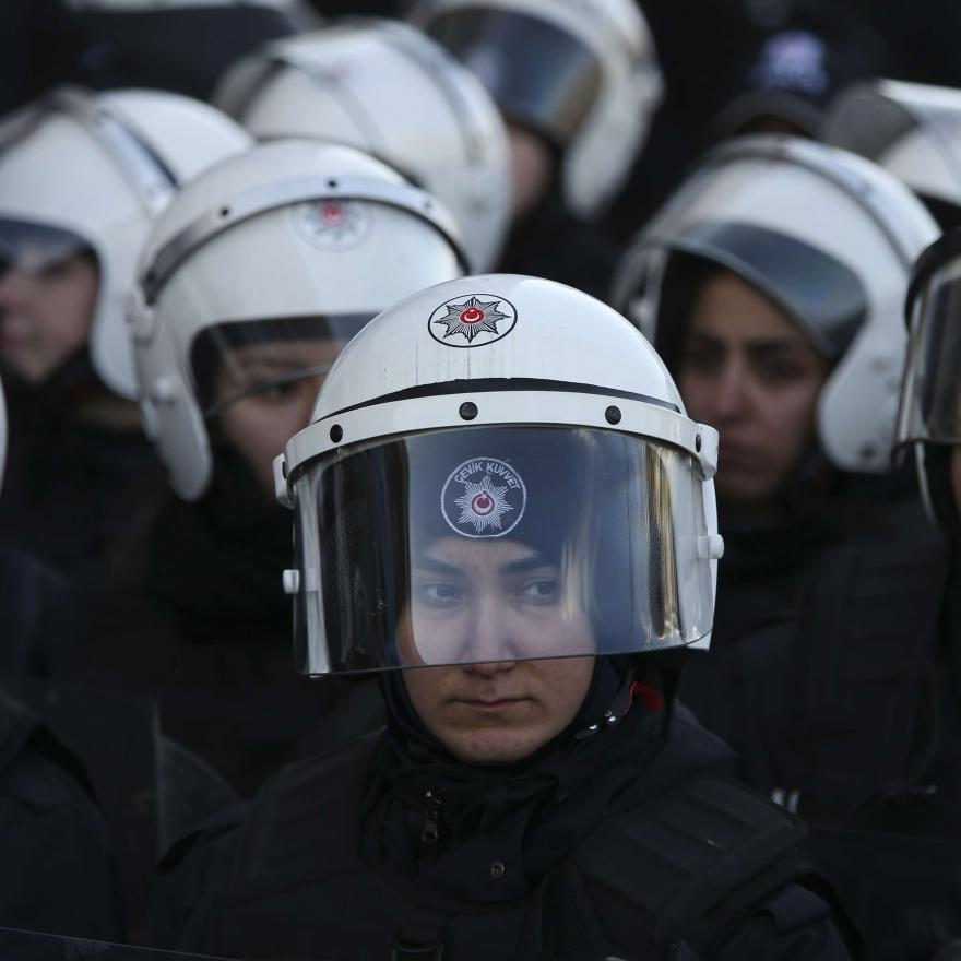 Turkish police officers in riot gear watch as members of the pro-Kurdish party HDP, or Peoples' Democratic Party, stage a sit-in, Monday, Feb. 11, 2019 in Istanbul. (AP Photo/Lefteris Pitarakis)