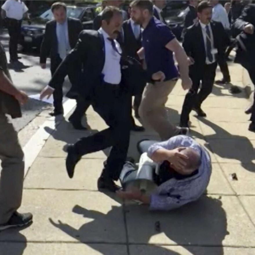 In this frame grab from video provided by Voice of America, members of Turkish President Recep Tayyip Erdogan's security detail are shown violently reacting to peaceful protesters during Erdogan's May 2017 trip to Washington