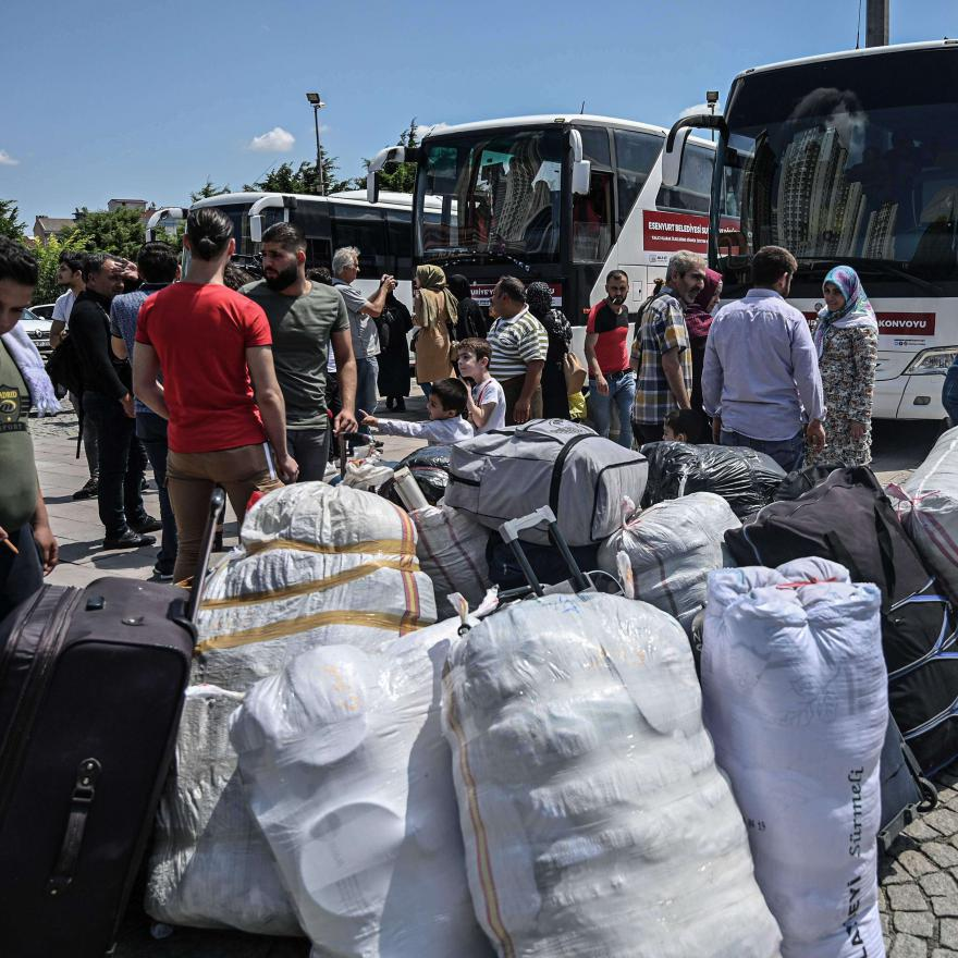 Syrian refugee families wait with other volunteers to board buses returning to neighbouring Syria in the Esenyurt district of Istanbul.