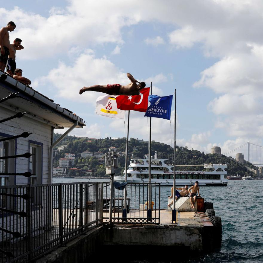 Young Turkish man dives into the Bosphorus
