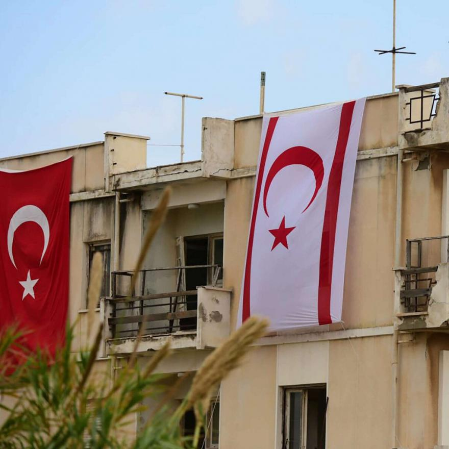 Turkish and TRNC flags on an abandoned building in Varosha, Cyprus in the breakaway Turkish Cypriot north. Photo taken before Turkish President Erdoğan's visit on Nov. 15, 2020. (AP Photo/Nedim Enginsoy)