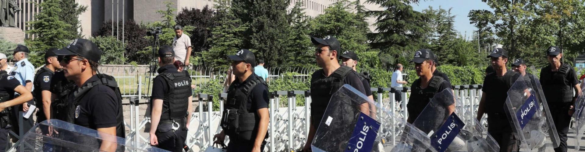 "Turkish riot police officers arrive with their shields in front of Ankara's courthouse on July 7, 2017, prior to the trial of the co-leader of the pro-Kurdish Peoples Democratic Party (HDP) Selahattin Demirtas charged of ""insulting"" a government official. / AFP PHOTO / ADEM ALTAN"
